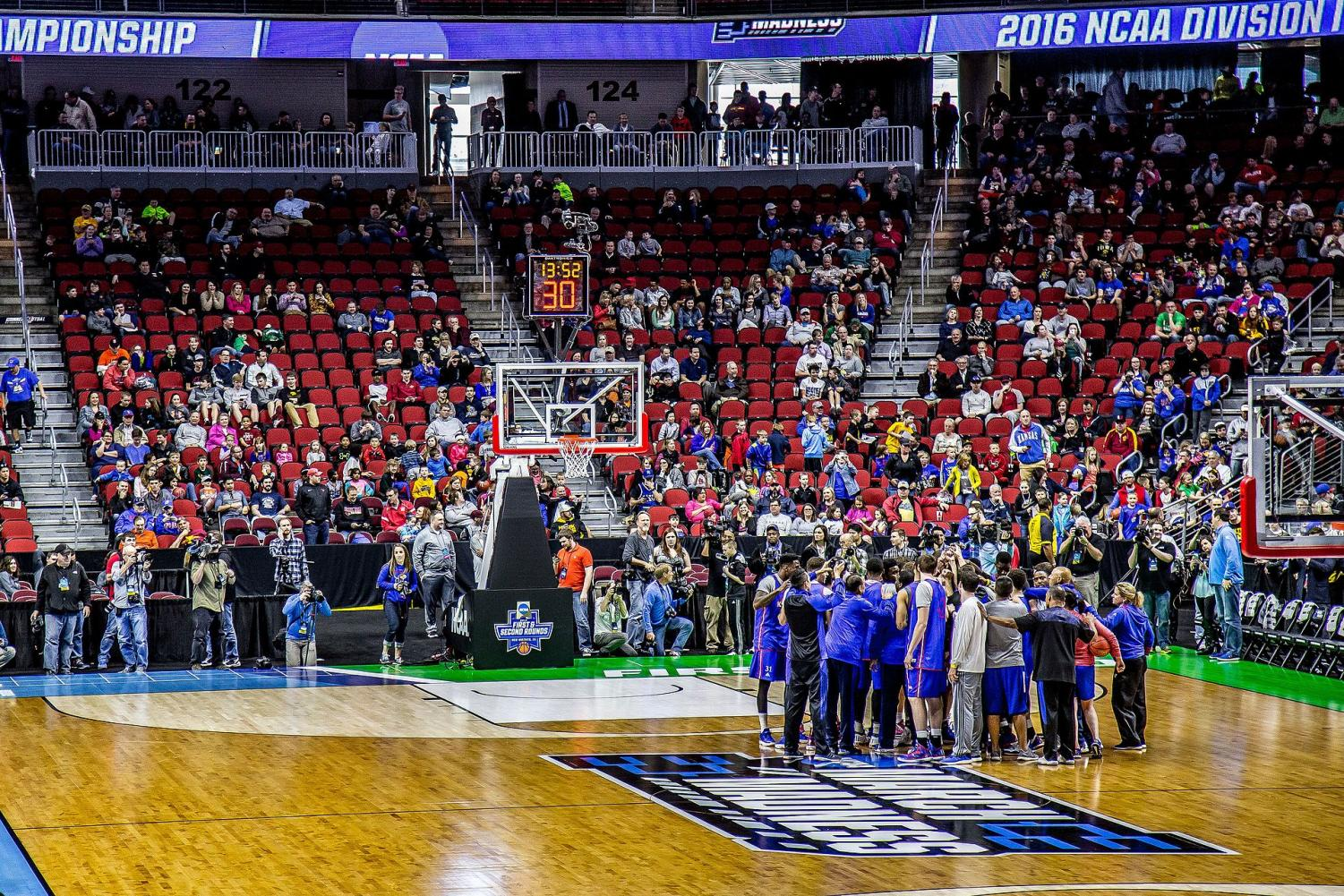 Players gather on the court before a March Madness basketball game