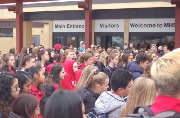 A+crowd+that+grew+to+over+180+students+gathers+in+front+of+the+school%E2%80%99s+main+entrance+on+November+19+to+listen+to+their+peers+speak+out+against+sexual+harassment+and+assault+at+MHS.+