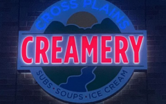 The Cross Plains Creamery sign, featuring their logo, was installed just a week before opening. Their logo will be sold on t-shirts, mugs, and hats.