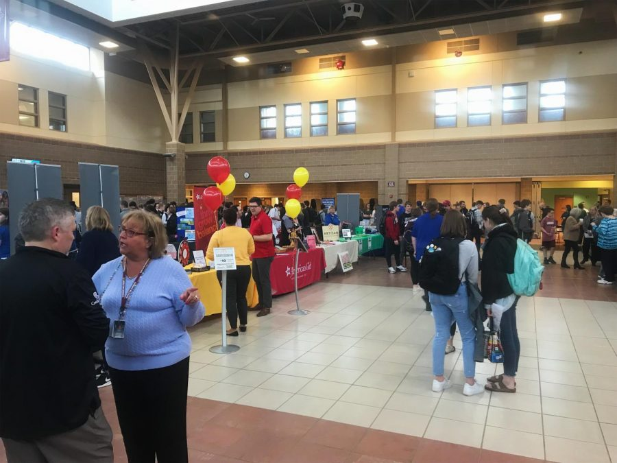 Middleton+High+School+Students+search+for+potential+jobs+at+the+2019+MHS+Job+Fair.