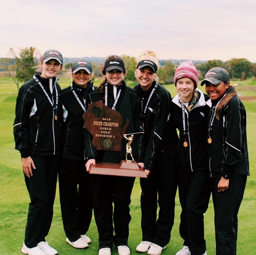 The Middleton Girls Golf team celebrates their State Championship victory at University Ridge Golf course October 14 and 15. The team shot a combined 651 over two days.