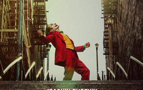 Joaquin Phoenix, who plays the Joker, dances on a staircase in the Joker's official movie poster.