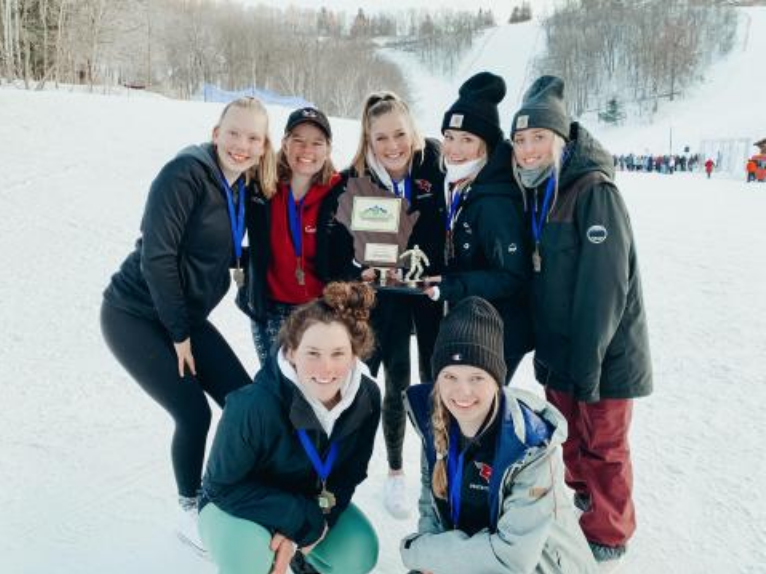 In+February%2C+the+MHS+girls+snowboard+team+finished+first+at+the+WIARA+State+Championships+with+an+impressive+104+points.+First-+time+coach%2C+Tony+Ziehmke%2C+credits+the+win+to+the+team%E2%80%99s+dedication.+