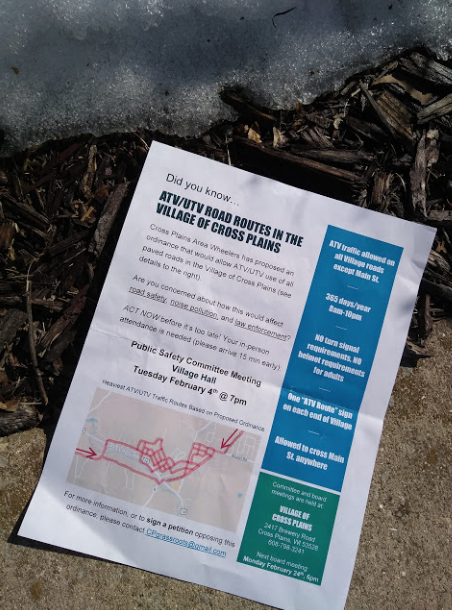 A flier distributed by CP Grassroots lays crumpled on a Cross Plains sidewalk.