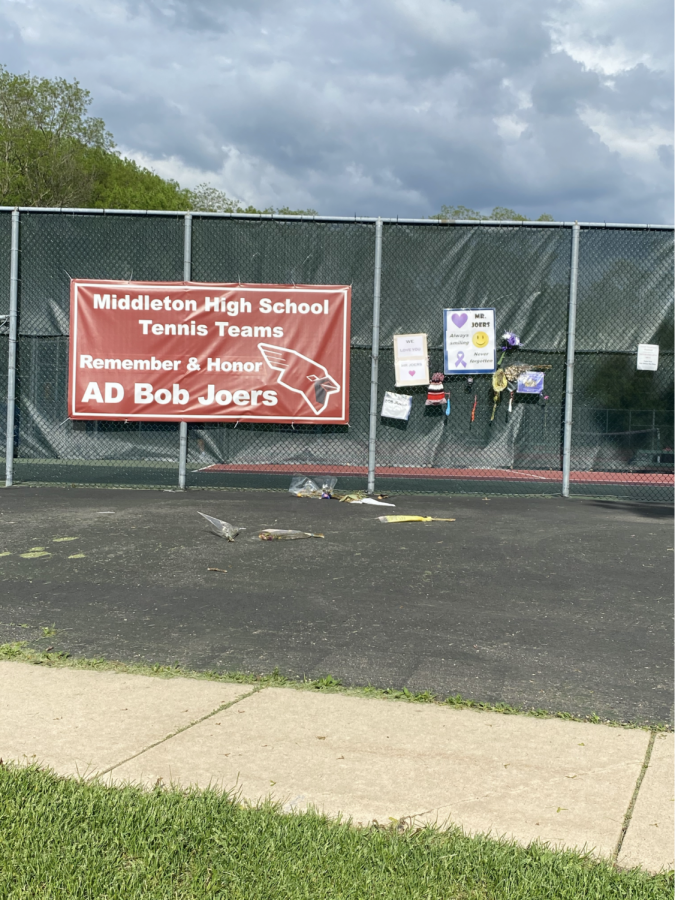 An MHS memorial for Bob Joers, created by the tennis teams, hangs on the tennis courts next to the school. Bob Joers will be missed.