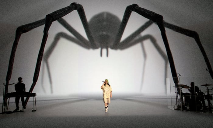 Billie Eilish live streamed a concert from a studio in L.A. with only her brother Finneas and her drummer Andrew performing with her. She used XR effects to create jaw-dropping visuals like this giant spider.