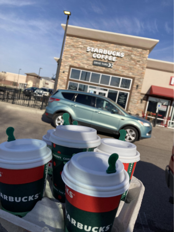 Starbucks' holiday drinks outside of Starbucks on Greenway Boulevard as lines wrap around the building to go through the drive-thru.
