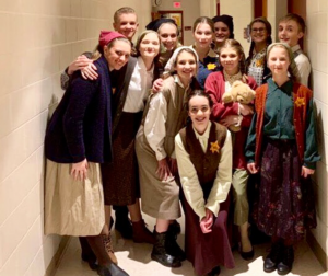 """Cast members from MHS theatre's production of """"I Never Saw Another Butterfly"""" gather after a February 2019 performance. Cast gatherings look different this year under COVID-19 restrictions. From left to right: Nick Tormey, Elora Doxtater, Nellie Gestring, Cate Ohly, Zoe Howard, Tanner Choate, Rhiannon Teschner, Vivian Szot, Ceia Kasper, Evelyn Williams, Johanna Bieske, Cheyenne Halverson."""