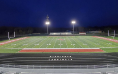 The stadium lights lit at Middleton High School. The stadium has not been full since March due to the pandemic.