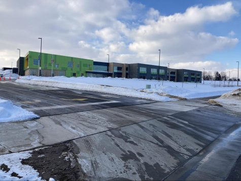 Construction of Pope Farm Elementary School (above) was completed in 2020, but students had not been in the new building until hybrid instruction began two weeks ago.