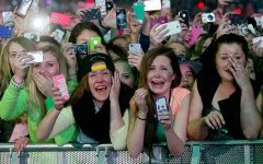 """""""We all know the image. A sea of young girls all crying and screaming from pure ecstasy, grabbing at their idol's clothes and losing themselves to an almost manic state just at the sight of their idol."""" - Lalaina Ratsimihah"""