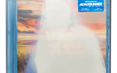 """The cover art for """"ROADRUNNER: NEW LIGHT, NEW MACHINE"""" shows a glowing white portrait of band member Joba in front of a field during a colorful sunset. The light outline alludes to the album title as well as the different themes and meanings of light throughout the album."""
